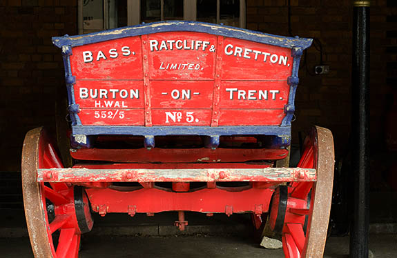 ENG: West Midlands Region, Staffordshire, The Trent Valley, Burton-on-Trent, Town Center, National Brewery Centre.  Red delivery wagon from the 19th c. [Ask for #270.041.]