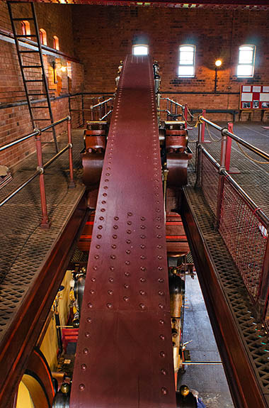 ENG: West Midlands Region, Staffordshire, The Trent Valley, Burton-on-Trent, Claymills Pumping Station, The massive beam of a restored and operating steam pumping engine [Ask for #270.221.]