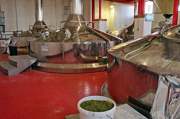 ENG: West Midlands Region, Staffordshire, The Trent Valley, Burton-on-Trent, Marstons Brewery, Shobnall, Mash tuns, in the brewery building, showing hops [Ask for #270.226.]