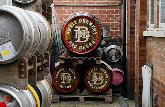 ENG: West Midlands Region, Staffordshire, The Trent Valley, Burton-on-Trent, Burton Bridge Brewery, Town Center, Casks and wooden barrels stacked behind the brewery, waiting to be shipped. [Ask for #270.239.]