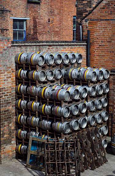 ENG: West Midlands Region, Staffordshire, The Trent Valley, Burton-on-Trent, Burton Bridge Brewery, Town Center, Casks stacked behind the brewery, waiting to be shipped [Ask for #270.243.]
